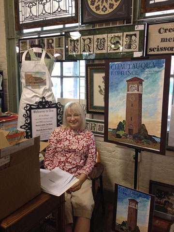 "Nancy Asmus at her ""Sewing Garden"" in the Meadville Market House"